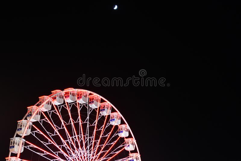 Ferris wheel and the moon. Black sky background. royalty free stock photos