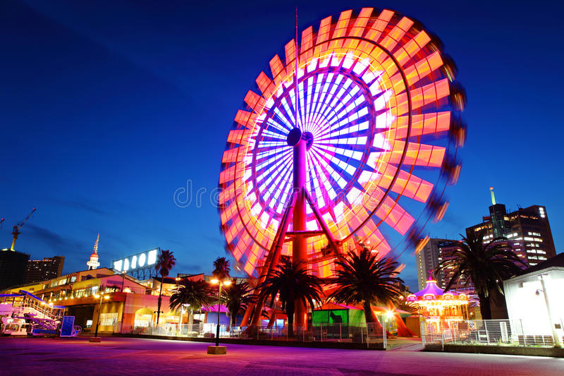 Ferris wheel at night. Moving Ferris wheel at night royalty free stock image