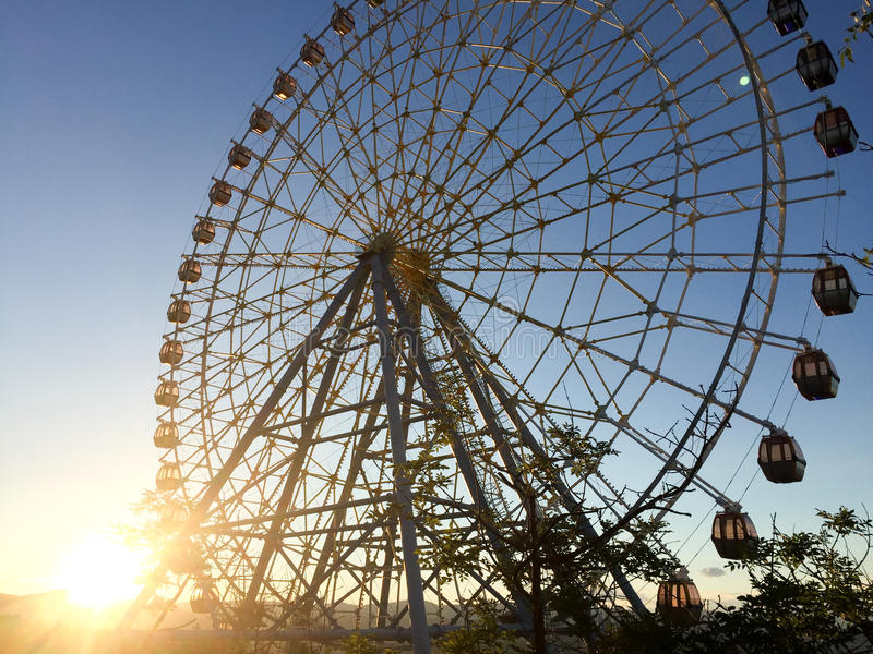 Ferris wheel over a blue sky at sunset royalty free stock photo