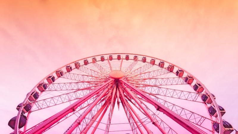 Ferris Wheel Over Cloudy Sky During Sunset royalty free stock image