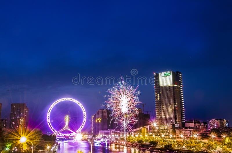 Ferris Wheel på bron med fyrverkerier royaltyfria foton