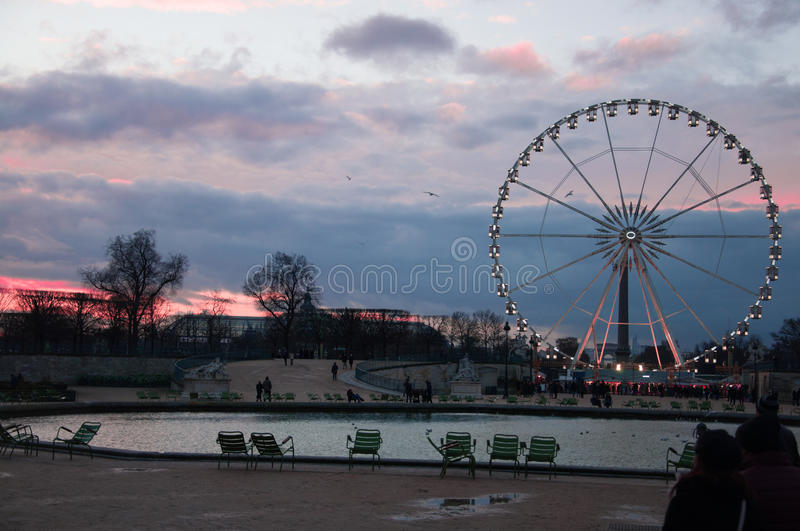 Ferris wheel in Paris. Roue de Paris. View from The Tuileries Garden. Sunset in Le jardin des Tuileries royalty free stock photography