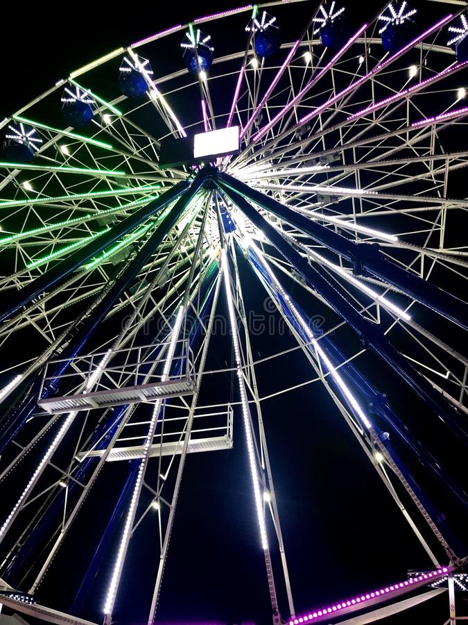 Ferris Wheel in Lights at Night royalty free stock image