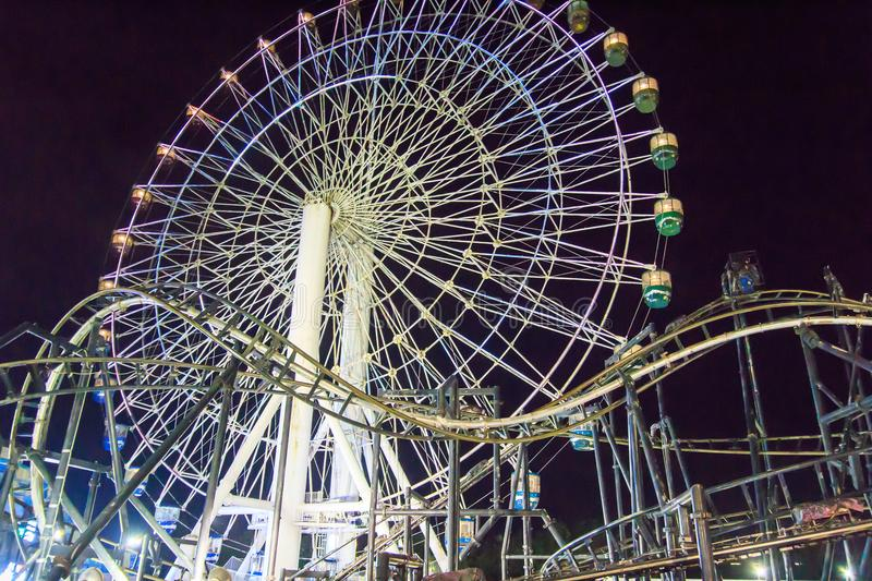 Ferris wheel and roller coaster track stock photos