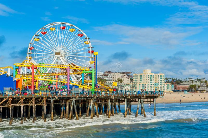 Ferris Wheel on Santa Monica Pier California USA. Ferris Wheel on Santa Monica Pier in California, USA. The pier is popular with residents and visitors as a stock photo