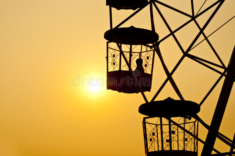 Ferris wheel silhouette. stock photos
