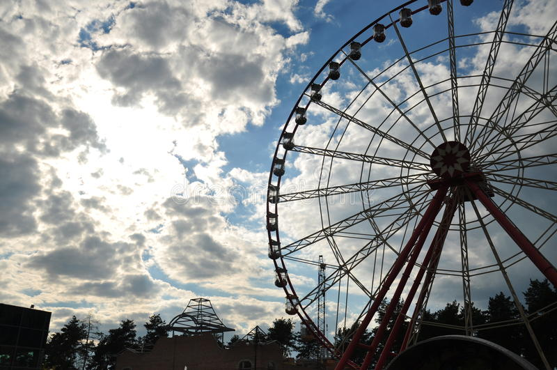 Ferris wheel on sky background stock photos