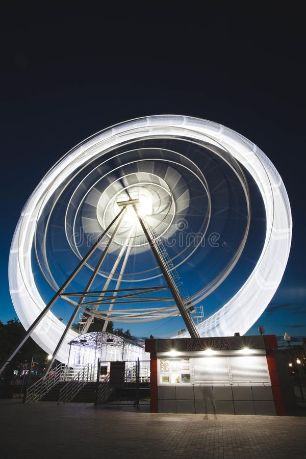 Ferris Wheel Spinning Long Exposure Neons Structure Black Night Rollercoaster. Entertainment, festival, lights, blur, carnival, architecture, bright stock photos