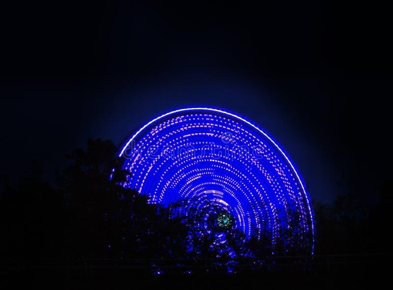 Ferris wheel spinning at night royalty free stock photo
