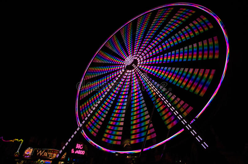 Ferris Wheel spinning at night royalty free stock photography