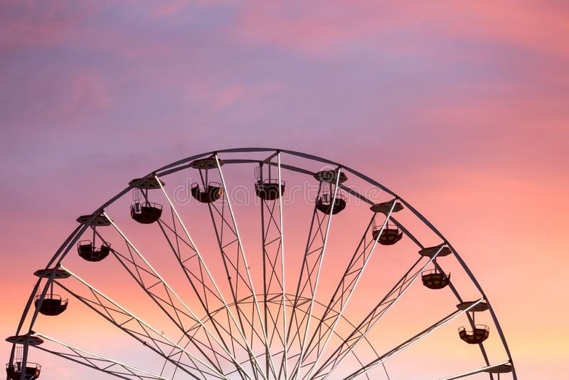 Ferris wheel at the sunset stock photos