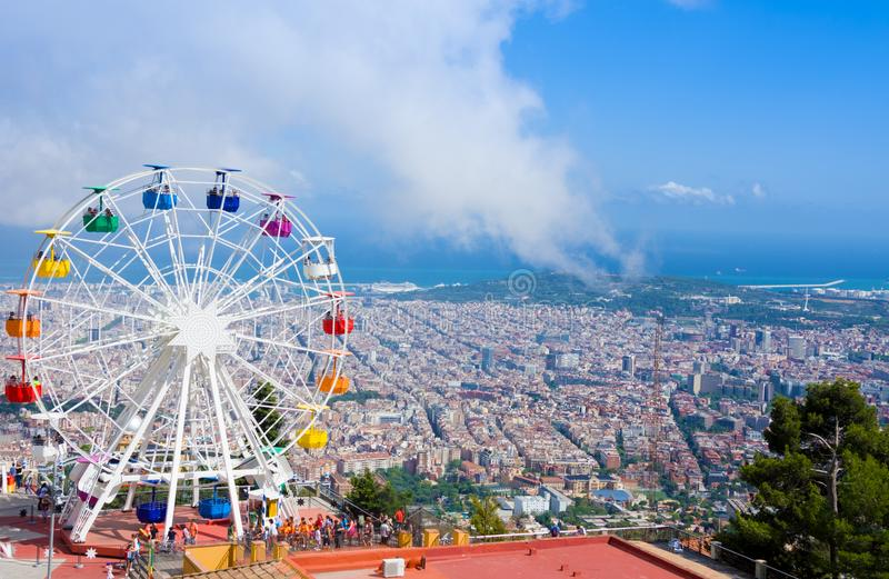 Ferris wheel in Tibidabo with panoramic view over Barcelona. It is located at free access area of. BARCELONA, SPAIN - JULY 13, 2016:Ferris wheel in Tibidabo with stock images