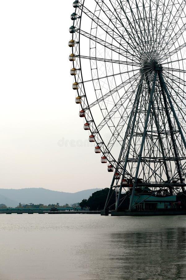 Ferris wheel on water. A ferris wheel on taihu lake in the city of WUXI, JIANGSU, CHINA stock images