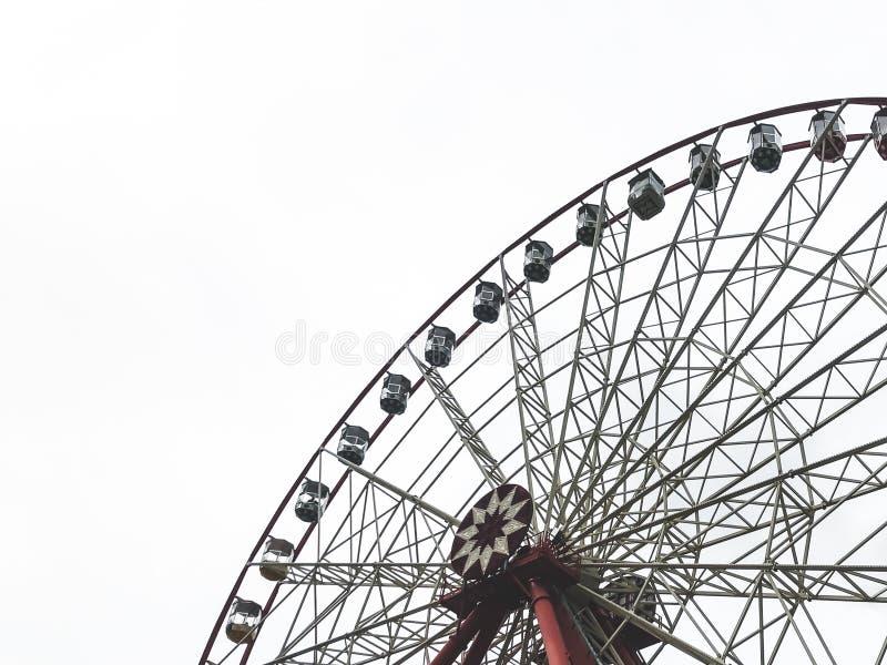 The ferris wheel and white sky on the background.Gorky Park, Kharkov city, Ukraine royalty free stock image