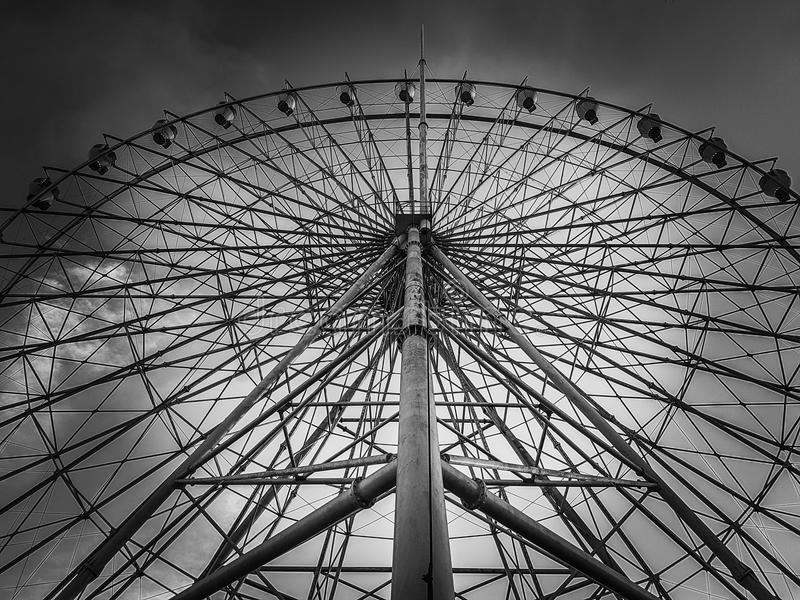 Ferris Wheel. You loved ferris wheels more than roller coasters because life shouldn't be lived at full speed, but in anticipation and appreciation stock photos