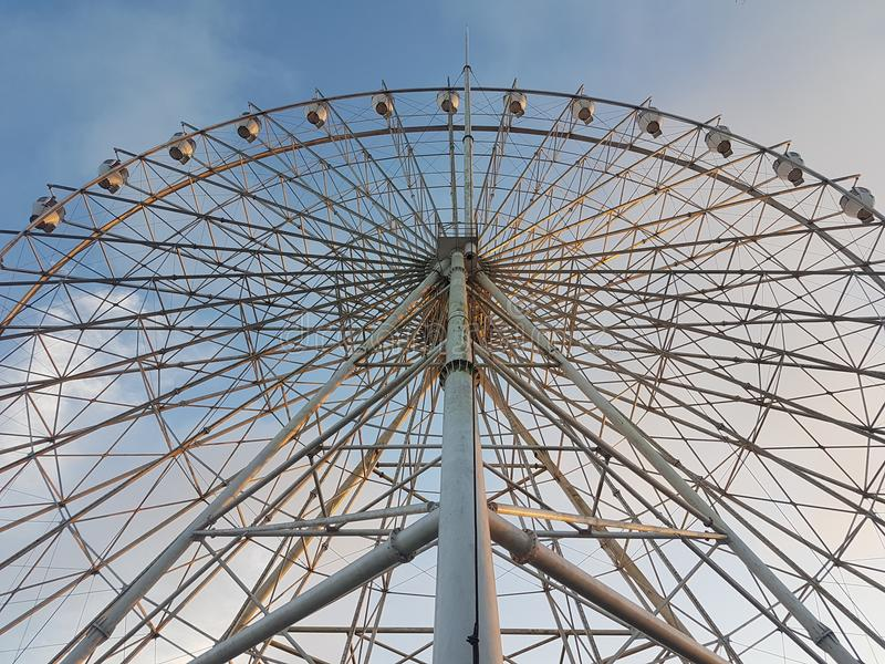Ferris Wheel. You loved ferris wheels more than roller coasters because life shouldn't be lived at full speed, but in anticipation and appreciation stock photography