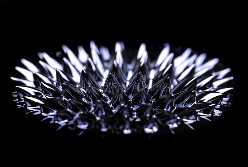 Ferro-fluid. Is a nanoscale mixture containing iron particles which react under a magnetic field, s are used as liquid seals and as friction-reducing fluids in royalty free stock image