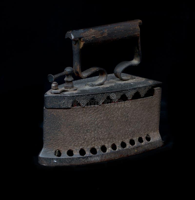 Ferro velho no carvão vegetal imagem de stock royalty free