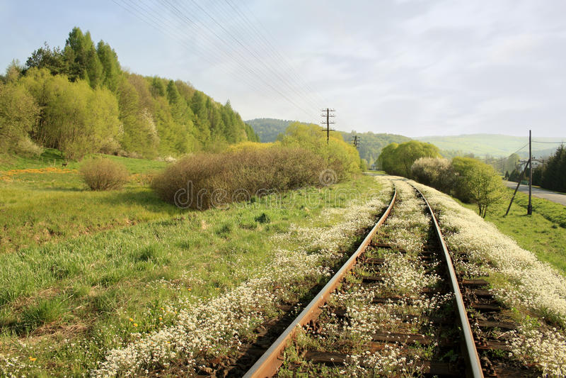 Ferrocarril del resorte imagen de archivo