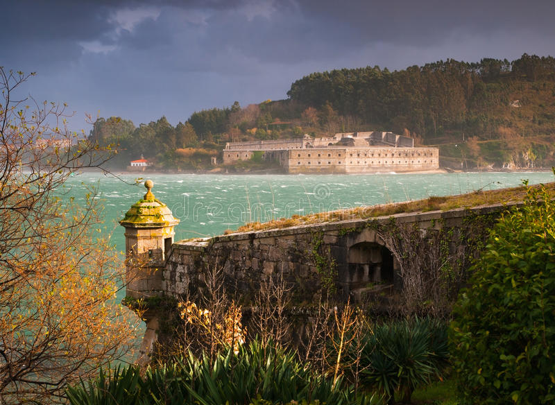 FERROL, SPAIN - FEBRUARY 08: San Felipe and La Palma castles on. February 08 , 2014, in Ferrol, Spain. These two castles are at the entrance of Ferrol estuary stock images