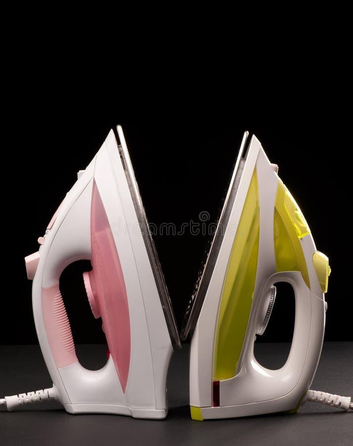 Ferros amarelos e cor-de-rosa foto de stock royalty free