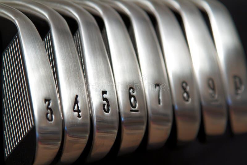 Ferros do golfe foto de stock