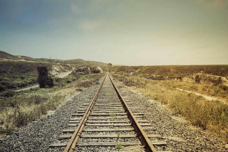 Ferrovia con la perdita leggera fotografia stock