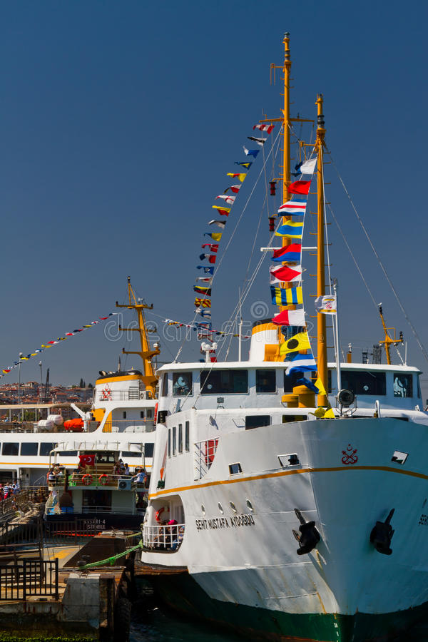 Ferry. A ferry at Eminonu passenger port on August 30, 2012 in Istanbul, Turkey. Ferries decorate by flags for Victory Day of Turkey royalty free stock image