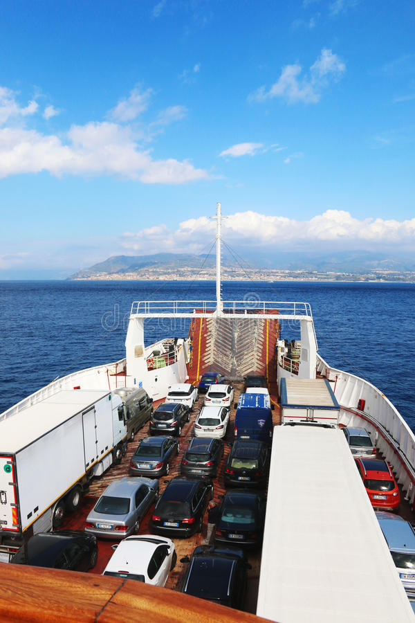Ferry boat with cars and trucks on the strait of Messina royalty free stock photos