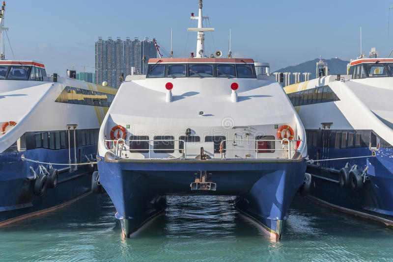 Ferry boat in Hong Kong harbor. Fast speed ferry boat in Hong Kong harbor royalty free stock image