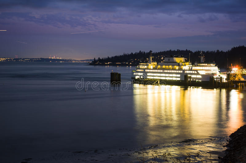 Ferry Boat Mt. Rainier at Night in Washington state. The ferry boat in Kingston, Washington state with the Seattle city lights in the background. Mount Rainier royalty free stock images