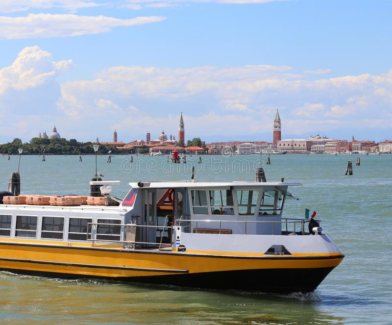Ferry boat navigates fast near Venice in Italy royalty free stock image