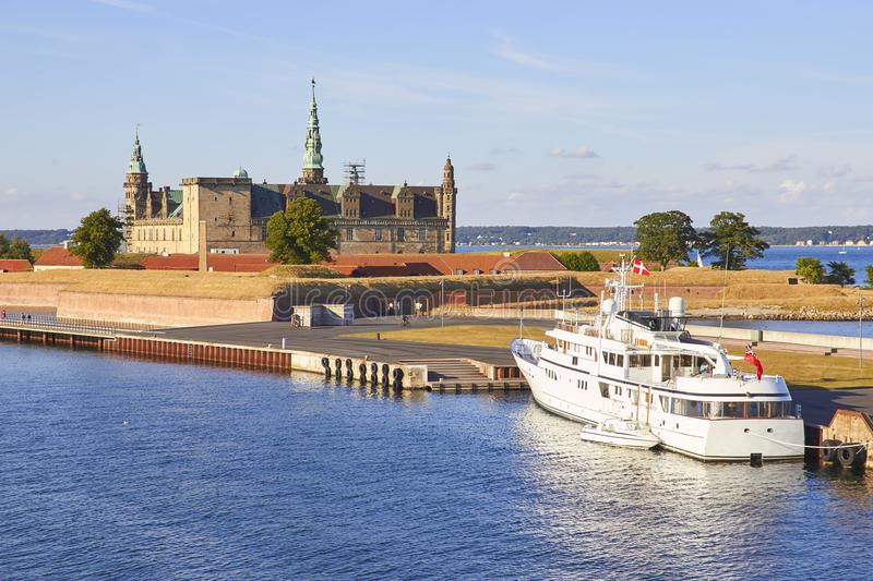 Ferry boat at pier, Kronborg castle at backgroung, Danmark, Europe. Ferry boat at pier, Kronborg castle at backgroung, Helsingor, Zealand, Danmark Europe stock photos
