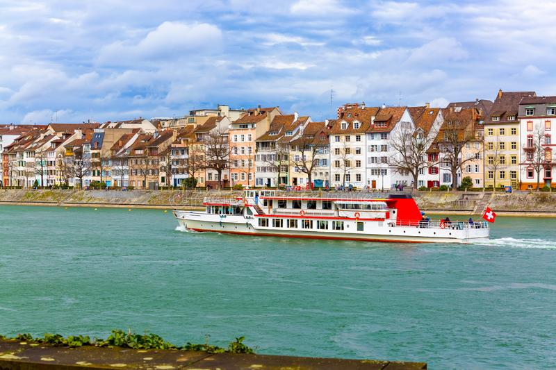 Ferry boat on Rhine river and old town building in Basel, Switzerland. Ferry boat on Rhine river and old town building in city Basel, Switzerland royalty free stock photography