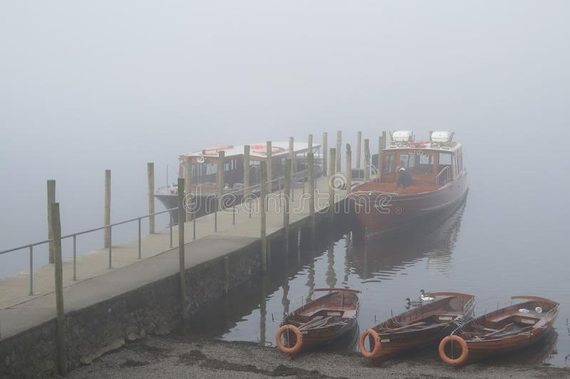 Ferry boats moored up in fog stock images