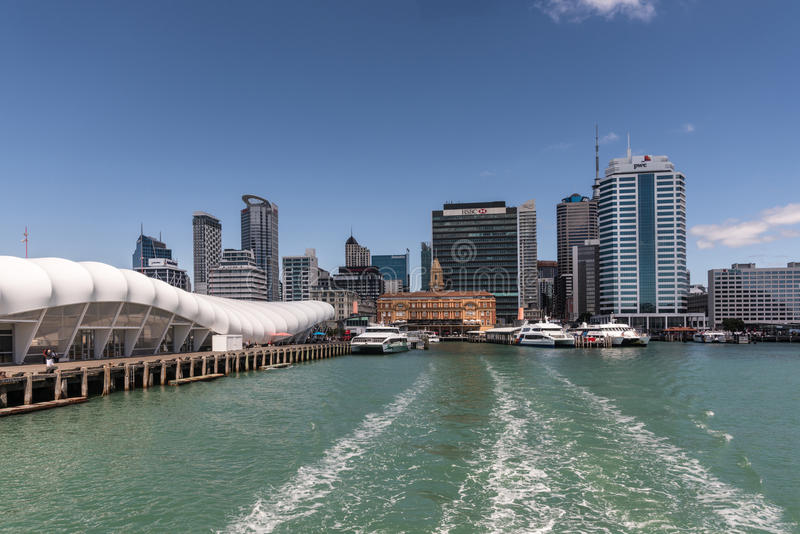 Ferry Building and Auckland skyline under blue sky. stock images