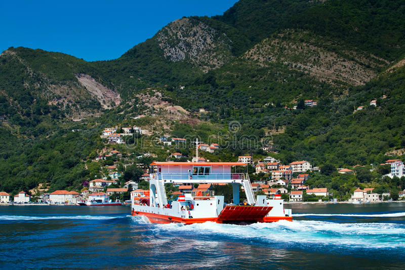 Ferry car boat in the Bay of Kotor city, Montenegro royalty free stock photography