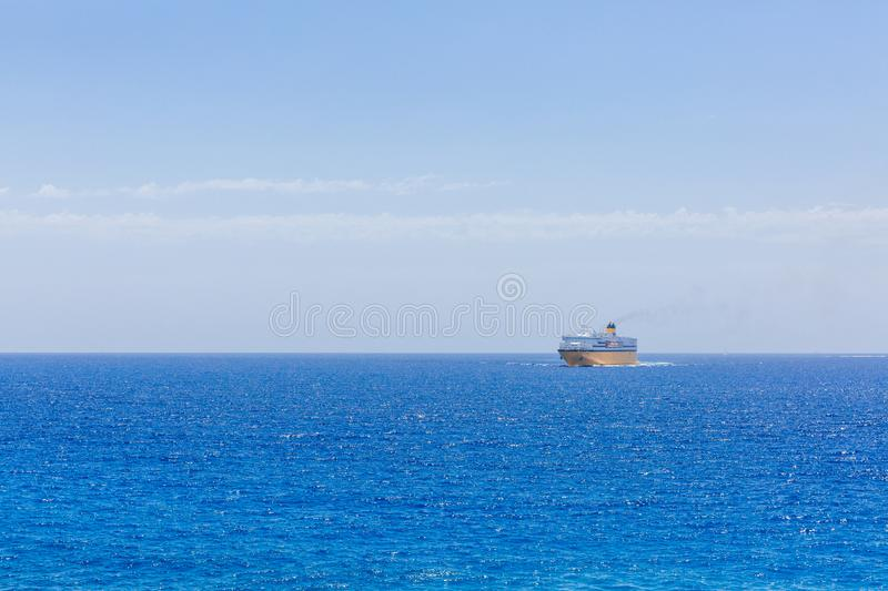 Ferry between Corsica and Nice traveling near horizon over blue stock photos