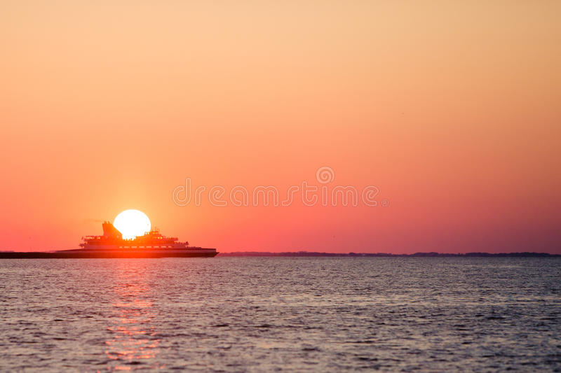 Ferry crossing during sunset. Atlantic Ocean Delaware bay royalty free stock image