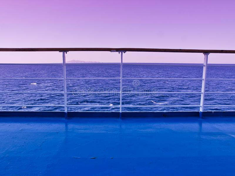 Ferry deck and railings with sea and horizon line. Background. Sunset / sunrise time beautiful purple sky stock photography