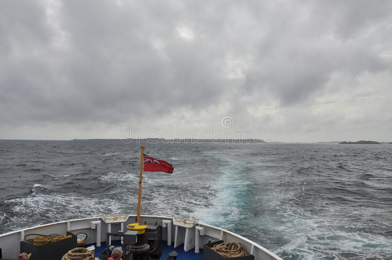 Ferry departing from the Scilly Islands, Overcast weather royalty free stock photo