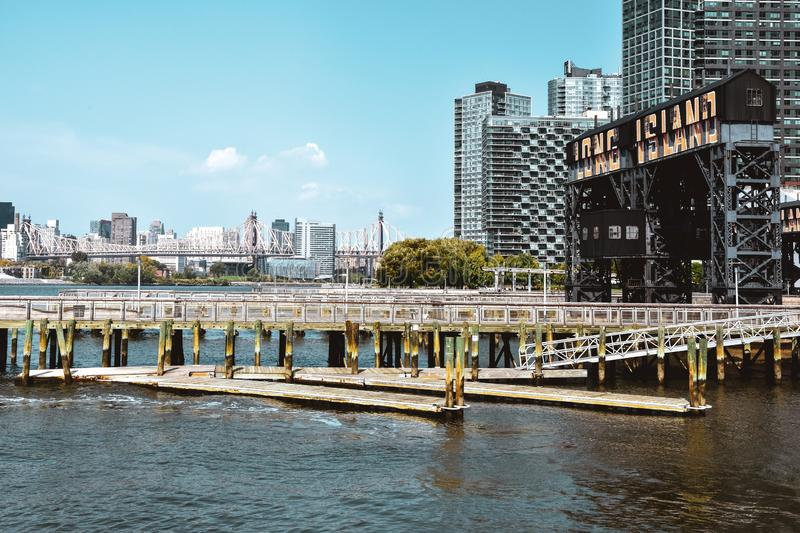 Ferry Dock at Long Island on a sunny day. Transportation and travel concept. Brooklyn, New York City, USA stock photography