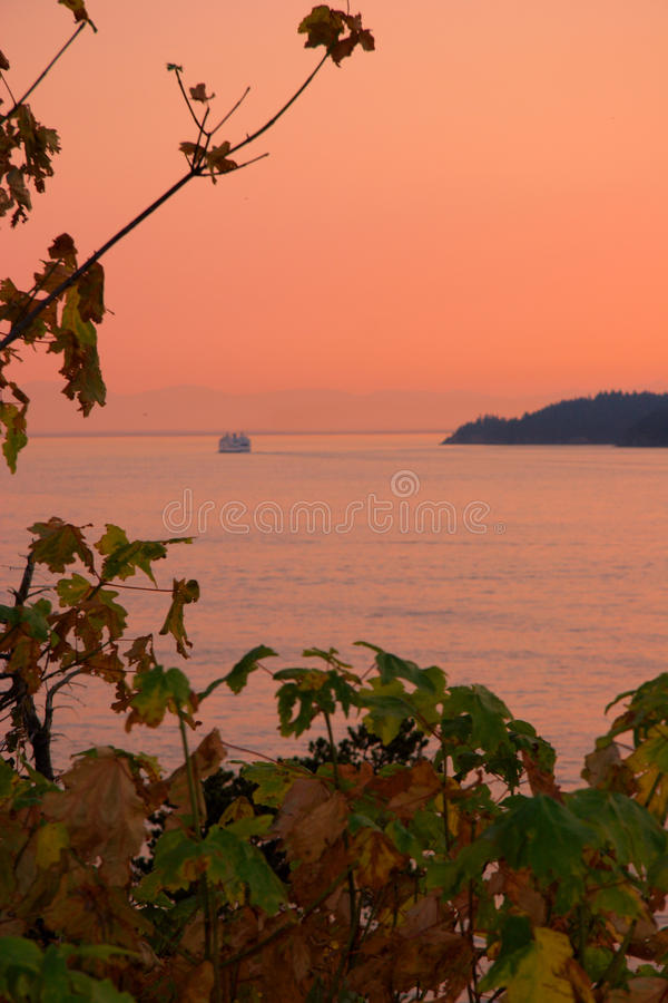 Ferry enroute from Horseshoe Bay to Nanaimo, West Vancouver, BC. BC Ferry enroute to Nanamo at sunset, as seen from Whytecliff Park, West Vancouver, BC stock photography
