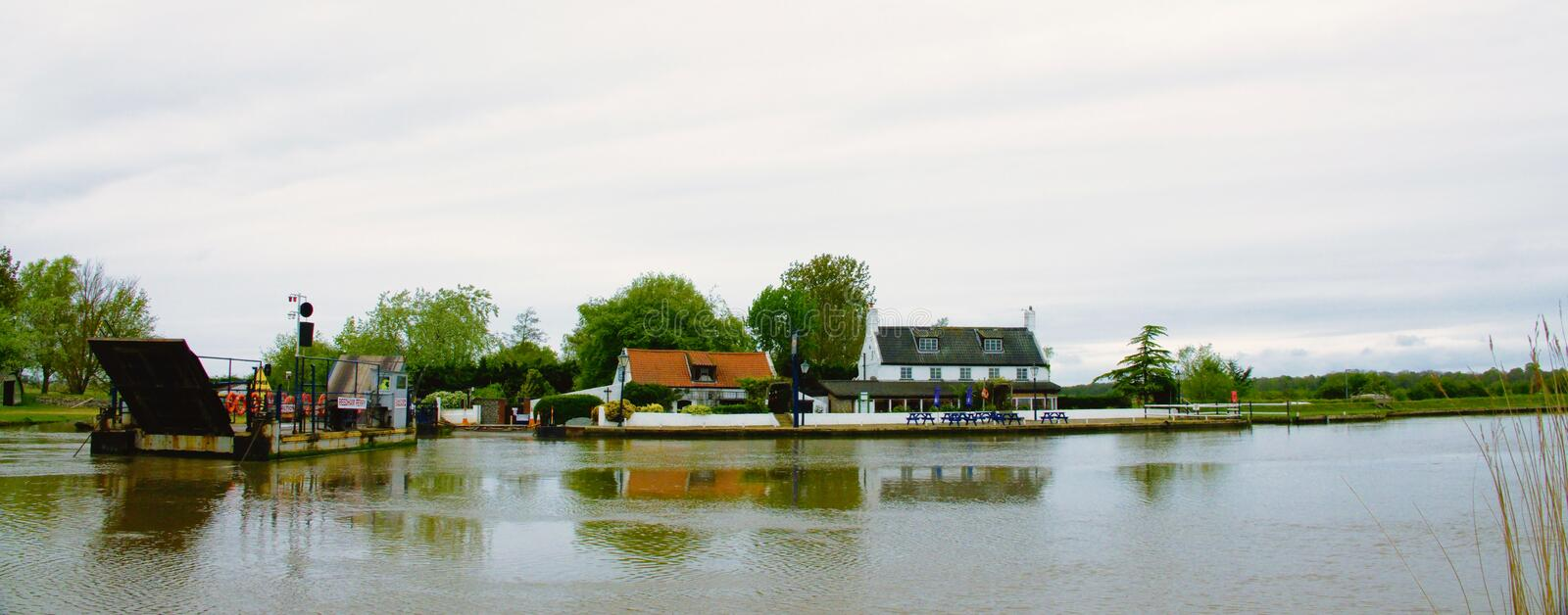 Ferry and Ferry Inn Reedham Norfolk. The Ferry and Ferry Inn on the banks of the river Yare near Reedham Norfolk UK royalty free stock photo