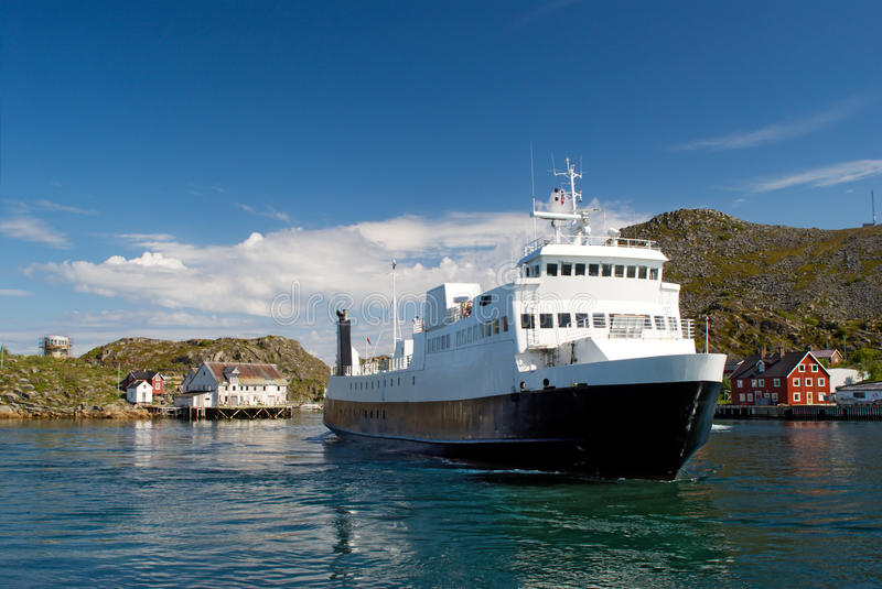 The ferry in a fjord of north Norway royalty free stock photo