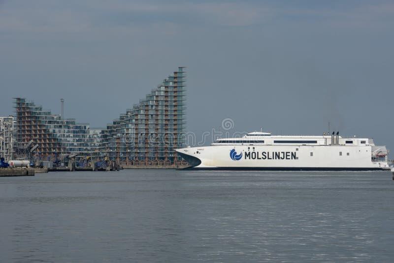 Ferry in front of modern residential neighborhood at Aarhus in Denmark stock photos