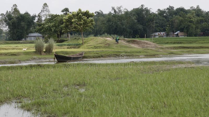 Ferry ghat Bangladesh Village scene river with small boat stock images