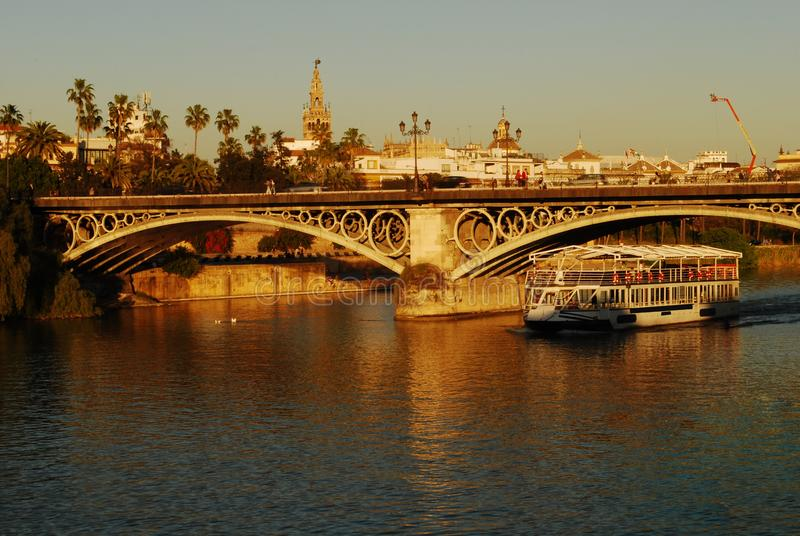 With the ferry on the Guadalquivir, to view Seville, Spain. Discovering Andalusia, the beautiful region in the south of spain, for many centuries dominated by stock photo