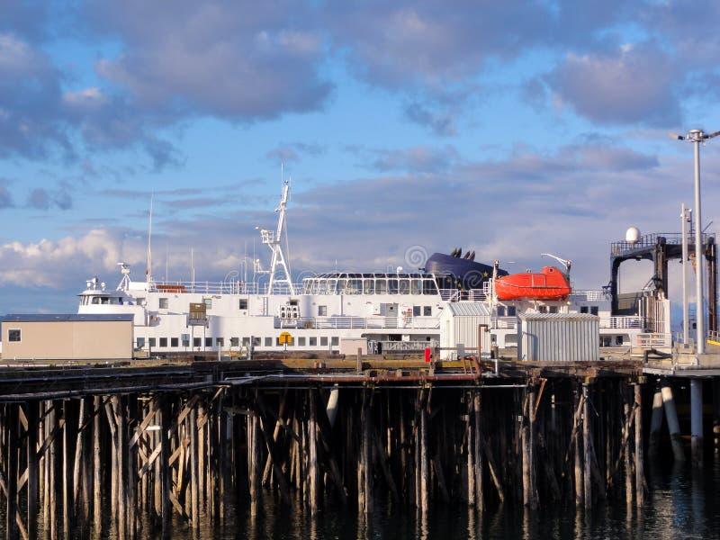 Ferry from Homer. Ferry docked at Homer, Alaska. Leaving for Kodaik, Alaska under a moody sky royalty free stock photo