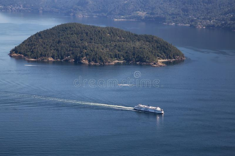 Ferry in Howe Sound Aerial View. Howe Sound, Vancouver, BC, Canada - July 21, 2018: Aerial view of BC Ferry traveling in the ocean during a vibrant sunny summer stock images